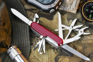 A Swiss Army style of muli-tool knife and equipment for use in the great outdoors.